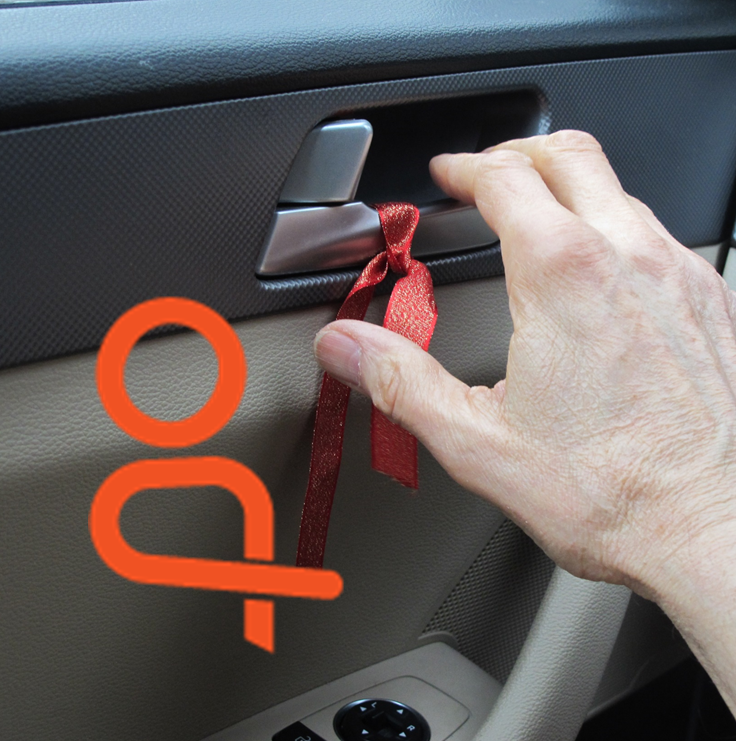 Far hand to latch with reminder ribbon, with Dutch Reach icon.