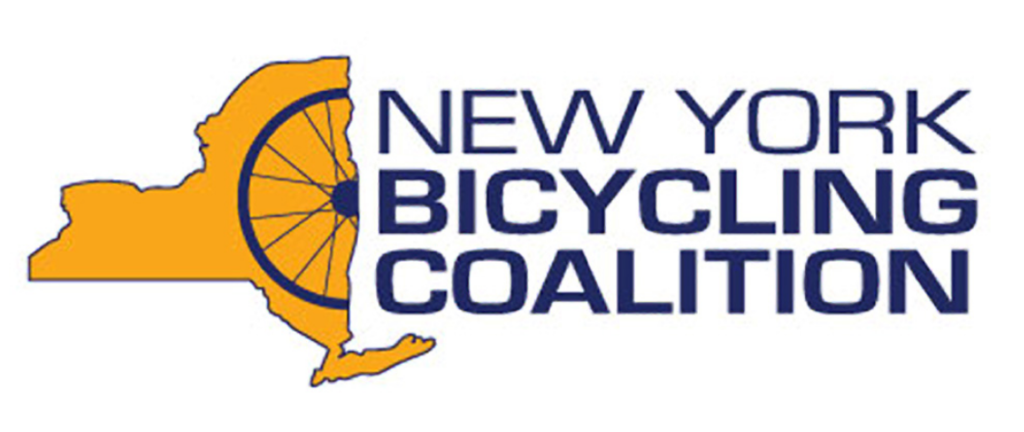 New York Bicycling Coalition logo in color with outside of NY State in orange, with half a bicycle spoked wheel superimposed.
