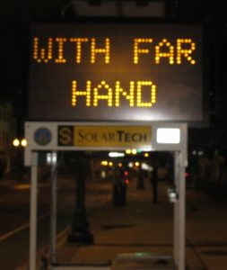 a3_with-far-hand-somervillema-sign