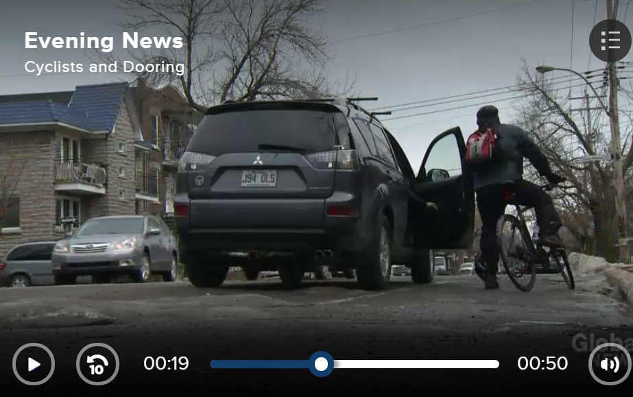 Screen shot from Global News report (2014) on launch of 'One Door One Life' anti dooring campaign by Montreal cycling safety advocates..  Shown is a staging of a doored cyclist standing beisde open obstructive door flung from the left into bike lane.
