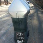 "Anti dooring sticker on parking meter, Brookline, MA, USA - 2016. Unknown bike safety activists ""vandalized"" meters in Boston, Cambridge, Brookline & possibly elsewhere with ""Open With Care"" advice. Click image to enlarge."