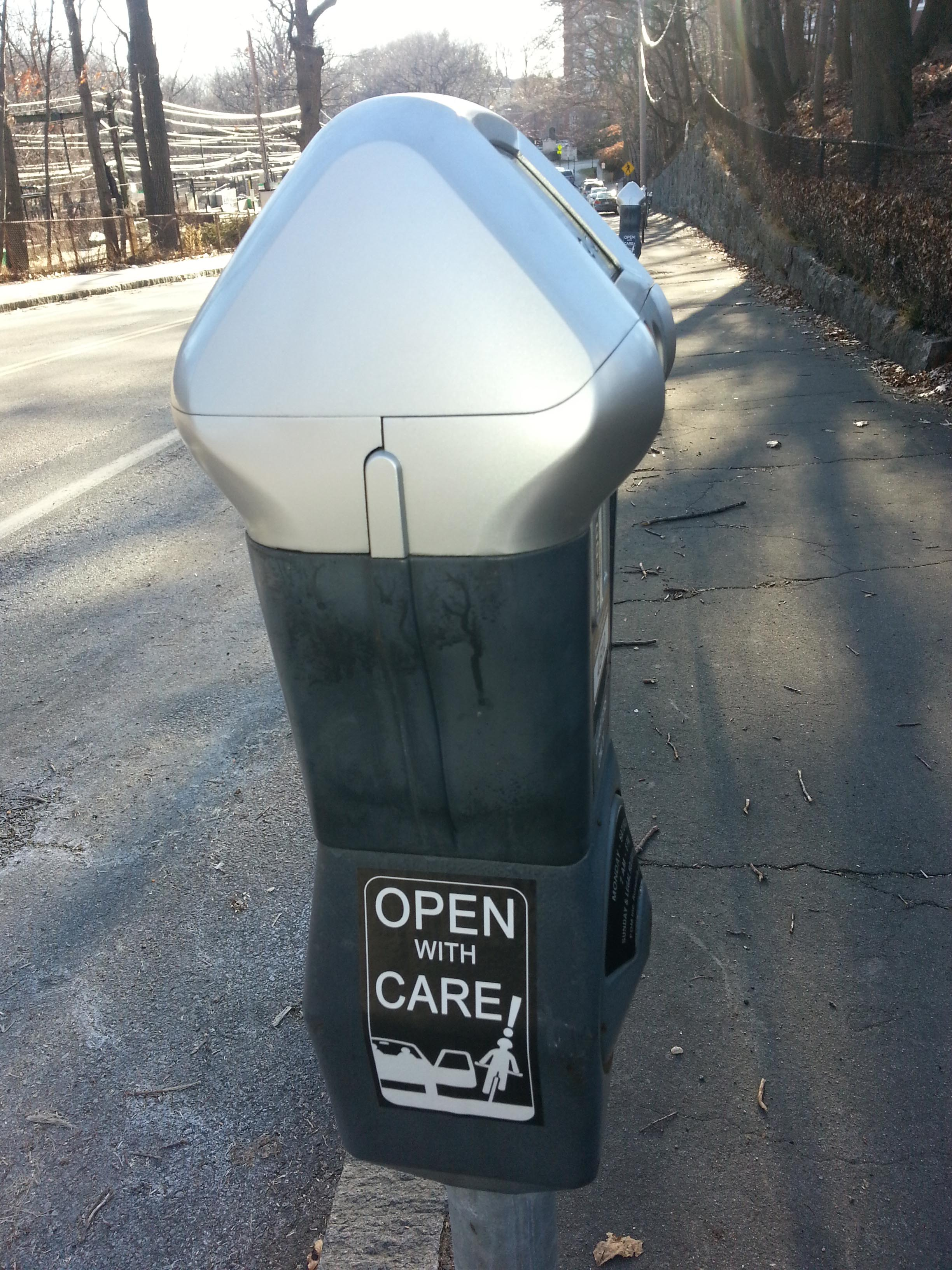 """Anti dooring sticker on parking meter, Brookline, MA, USA - 2016. Unknown bike safety activists """"vandalized"""" meters in Boston, Cambridge, Brookline & possibly elsewhere with """"Open With Care"""" advice. Click image to enlarge."""