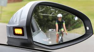Rear facing radar alerts driver of on-coming cyclists with side mirror flashing LED - Audi A4 2016.