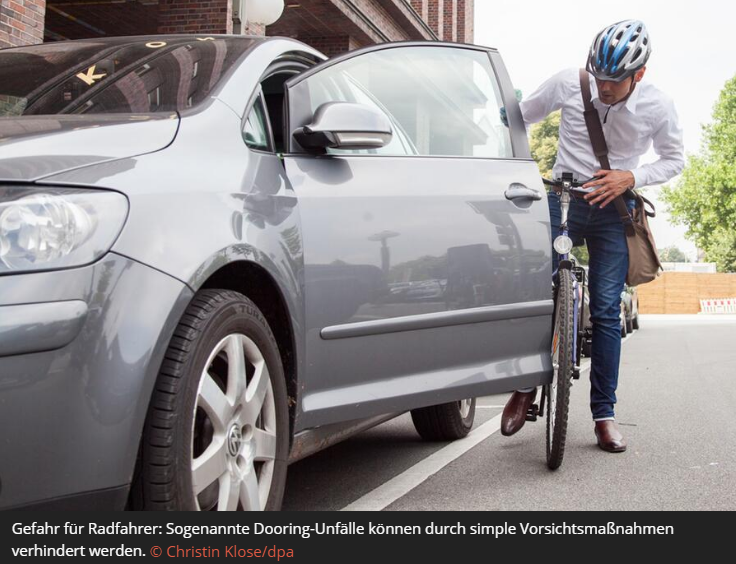 "Photo of cyclist about to be doored seen from front. Appeared in Auto Service article on website 19 June 2017, with with article explaining the Dutch Reach following a recent dooring in Berlin by a Saudi driver who claimed diplomatic immunity. Title of article:  Gefährliche Dooring-Unfälle: Wie der ""holländische Griff"" Leben retten kann."