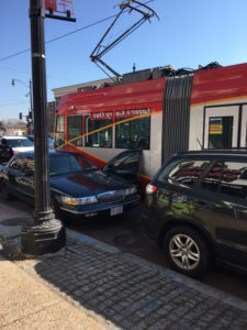 Street car doored by auto in Washington, D.C. Feb. 21, 2017.