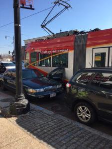 Street car doored by auto in Washington, D.C. Feb. 21, 2017.